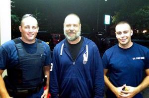 A photo provided by the US Coast Guard  shows Russell Crowe, center, with Coast Guard petty officers  Robert Swieciki, left,  and Thomas Watson Sunday Sept. 2, 2012.