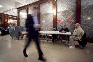 A resident of a luxury apartment building on Wall Street walks through the lobby of his building.