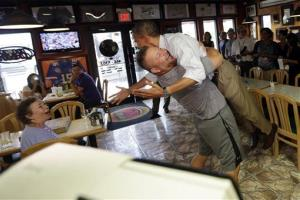 President Obama is picked up and lifted off the ground by Scott Van Duzer, owner of Big Apple Pizza and Pasta Italian Restaurant in Ft. Pierce, Fla.