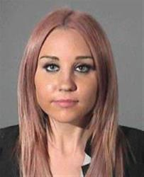 This booking photo released by Los Angeles Conty Sheriff's Department shows actress Amanda Bynes, 26, who was arrested on suspicion of drunken driving after allegedly hitting a sheriff's patrol car.