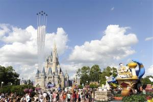 In this publicity image released by Disney, the US Air Force Thunderbirds fly over the Magic Kingdom on Tuesday, Oct. 26, 2010, in Lake Buena Vista, Fla.
