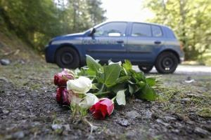 A photo of flowers at the scene of the massacre in the French Alps.