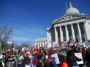 People stand in front of the Capital in Madison, Wisconsin, earlier this year.