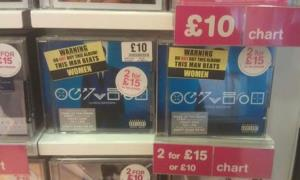 Here are the stickers slapped on copies of Chris Brown's latest CD.