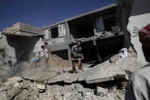 Syrians clear the rubble of a house which was destroyed in government airstrike on Saturday, in Kal Jubrin, on the outskirts of Aleppo, Syria, Sunday, Sept. 16, 2012.