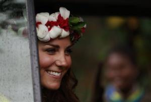 Britain's Kate, the Duchess of Cambridge, smiles to locals as she departs the Cultural village in Honiara Monday, Sept. 17, 2012. Britain's Prince William, the Duke of Cambridge, and his wife Kate are on their third stop of a nine-day tour of Southeast Asia and the South Pacific on behalf...