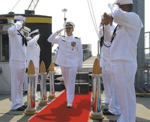 In this Aug. 3 photo provided by the Navy, Cmdr. Michael P. Ward II, center, is saluted during the change-of-command ceremony for the nuclear submarine USS Pittsburgh in Groton, Conn.