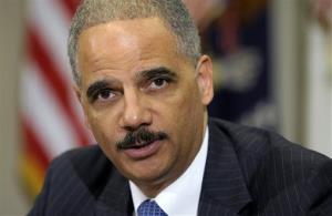 In this July 26 file photo, Attorney General Eric Holder speaks in the Cabinet Room of the White House.