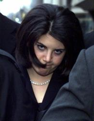 Monica Lewinsky and her entourage walk back to a hotel in Washington in this Feb. 2, 1999, file photo.