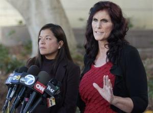 Cindy Lee Garcia, right, one of the actresses in Innocence of Muslims, and attorney M. Cris Armenta hold a news conference in Los Angeles Thursday.