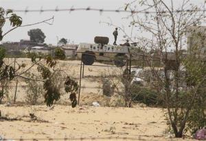 In this Aug. 6 file photo, Egyptian border guards patrol near the border with Israel in Rafah, Egypt. Today's attack by militants involved Israeli border guards.