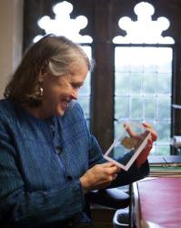Divinity professor Karen L. King holds a fourth-century fragment of papyrus that she says is the only existing ancient text that quotes Jesus explicitly referring to having a wife.