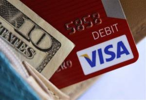 This file photo shows a Visa card in a wallet in Richardson, Texas.