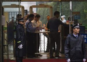 A man places his bag for a security check outside the Intermediate People's Court in Chengdu last week.