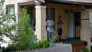 Young man appears to point gun in Street View photograph.