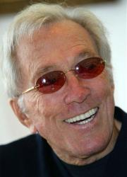 Andy Williams smiles as he speaks to reporters during his news conference in Tokyo in this July 25, 2004, file photo.