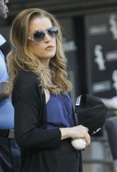 Lisa Marie Presley listens to the national anthem after throwing out a ceremonial first pitch before a baseball game, Wednesday, June 20, 2012, in Chicago.