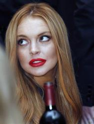 Lindsay Lohan attends the White House Correspondents' Association Dinner headlined by late-night comic Jimmy Kimmel, Saturday, April 28, 2012 in Washington.