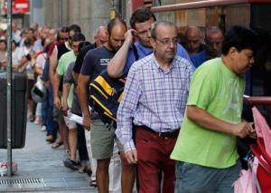 People enter a unemployment office in Madrid, Spain, Thursday, Aug. 2, 2012.