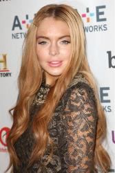 In this May 9, 2012 photo, actress Lindsay Lohan poses at the A&E Networks 2012 Upfront at Lincoln Center in New York.
