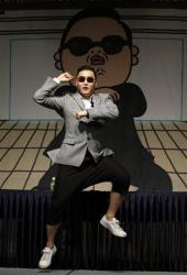 South Korean rapper PSY, who sings the popular Gangnam Style song, dances following his news conference in Seoul, South Korea, Tuesday, Sept. 25, 2012.