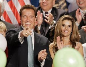 In this Nov. 6, 2006 file photo, Gov. Arnold Schwarzenegger celebrates with his wife Maria Shriver after giving his acceptance speech, in Beverly Hills, Calif.