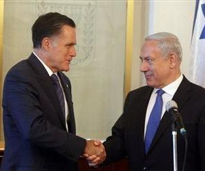 Israeli Prime Minister Benjamin Netanyahu, right, and Mitt Romney shake hands at the Prime Minister's office in Jerusalem, July 29, 2012.