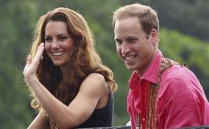 Britain's Prince William and his wife Kate, the Duke and Duchess of Cambridge, smile as they watch a shark ceremony as they arrive at Marapa Island, Solomon Islands, Monday, Sept. 17, 2012.