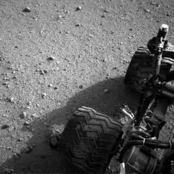 This image released by NASA on Wednesday Aug. 29,2012 shows Curiosity's wheels after it made its third drive on Mars.
