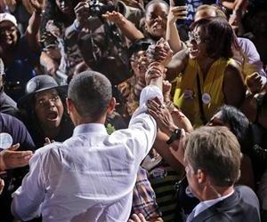 President Barack Obama, center, greets supporters after speaking at a campaign event in Desert Pines High School, Sunday, Sept. 30, 2012 in Las Vegas.