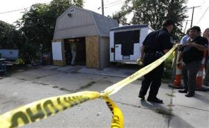 Police tape blocks a driveway where authorities drilled for soil samples in the floor of a shed at a Roseville, Mich., home.