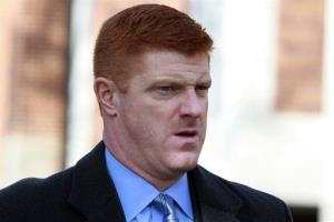 In this Jan. 25, 2012, file photo, former Penn State assistant football coach Mike McQueary arrives on the Penn State campus for the funeral of Joe Paterno.