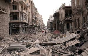 Syrian men walk at a street between destroyed buildings where triple bombs rocked at the Saadallah al-Jabri square, in Aleppo city, Syria, Wednesday Oct. 3, 2012.