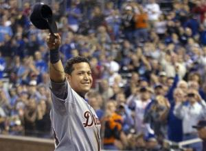 Detroit Tigers' Miguel Cabrera waves to the crowd after being replaced during the fourth inning. He has won the rare Triple Crown in baseball.