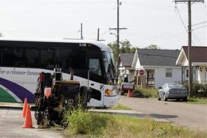A tour bus turns a corner in the Lower 9th Ward section of New Orleans, Tuesday, Oct. 2, 2012.