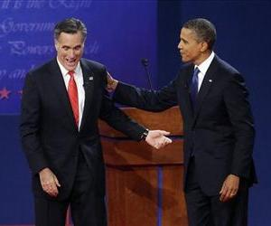 Mitt Romney, left, and President Barack Obama, right, talk at the end of their first debate at the University of Denver, Oct. 3, 2012.