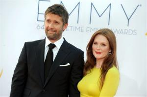 Actress Julianne Moore, right, and her husband Bart Freundlich arrive at the 64th Primetime Emmy Awards at the Nokia Theatre on Sunday, Sept. 23, 2012, in Los Angeles.