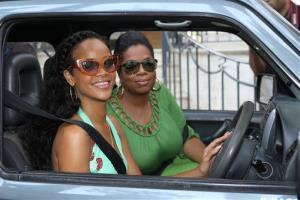 This Aug. 4, 2012 image released by Harpo Productions shows singer Rihanna, left, with Oprah Winfrey during an interview for Oprah's Next Chapter in Barbados.