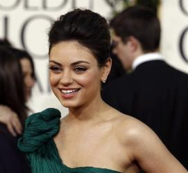 Mila Kunis arrives at the Golden Globe Awards Sunday, Jan. 16, 2011, in Beverly Hills, Calif.