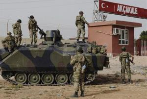In this Sunday, Oct. 7, 2012 file photo, Turkish military station at the border gate with Syria, across from Syrian rebel-controlled Tel Abyad town, in Akcakale, Turkey.
