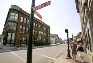 In this 2007 file photo, pedestrians stroll through downtown Middleborough, Mass.