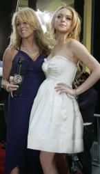 Lindsay Lohan poses with her mother Dina as she arrives for the New York premiere of Georgia Rule Tuesday May 8, 2007.