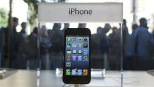 People queue outside the Apple Store as the iPhone 5 mobile phones went on sale in Amsterdam, Netherlands, Friday Sept. 28, 2012.