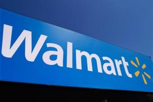 In this May 16, 2011 photo, the Walmart logo is displayed on a store in Springfield, Ill.