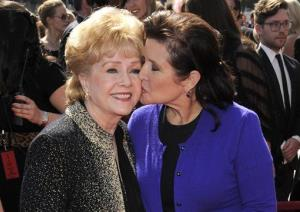 Debbie Reynolds, left, and daughter Carrie Fisher arrive at the Primetime Creative Arts Emmy Awards on Sept. 10, 2011, in Los Angeles.