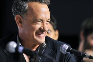 Tom Hanks laughs during the press conference for the film Cloud Atlas during the 2012 Toronto International Film Festival.