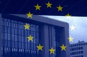 The European Council building is reflected in a photograph of the EU flag on the wall of the European Council building in Brussels.