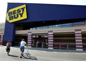 In this Thursday, June 21, 2012, file photo, customers walk in and out of Best Buy in Danvers, Mass.