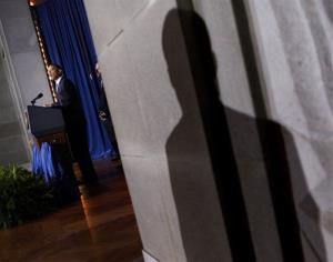 The shadow of a Secret Service agent is seen as President Barack Obama speaks in Washington in 2010.