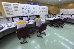 In this 2010 photo, Iranian technicians work at the Bushehr nuclear power plant, outside the southern city of Bushehr, Iran. The plant got hit with a major computer virus attack.